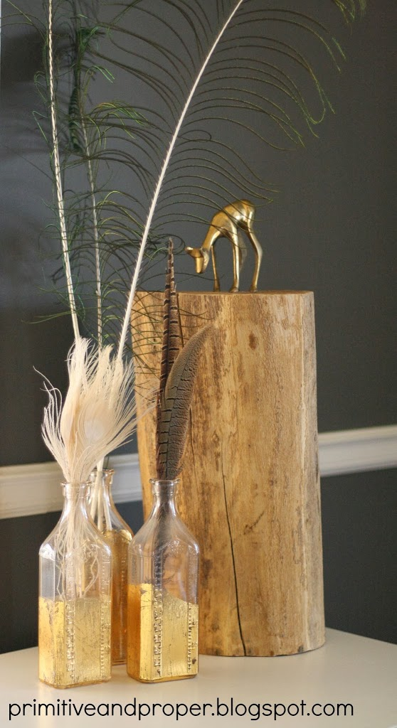 gold-leaf-bottles-dining-vignette-with-tree-stump