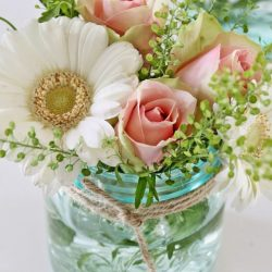 mason jar with daisies
