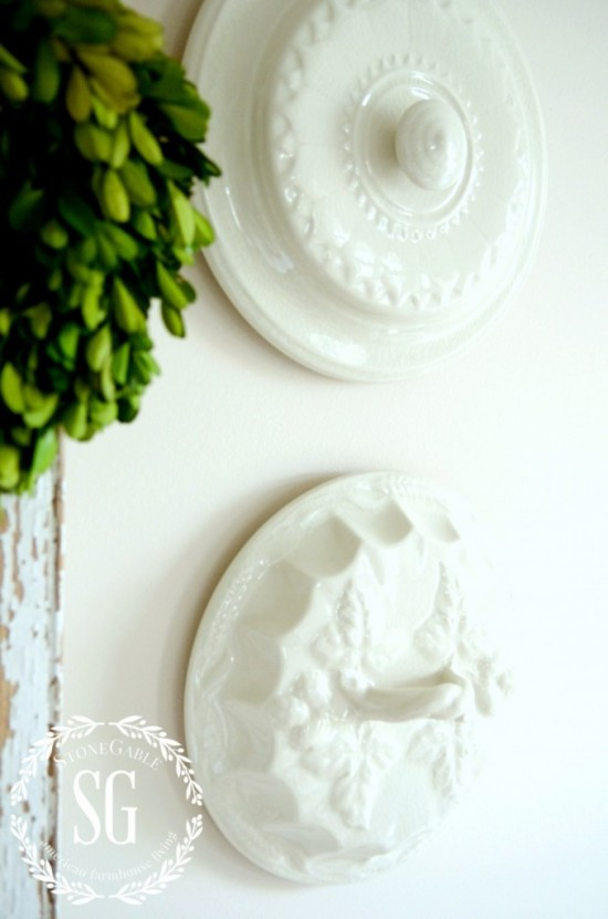 THE-BEST-WAY-TO-HANG-PLATES-ON-THE-WALL-WITHOUT-WIRES-OR-MAGIC-suspended-lids-stonegableblog.com_-678x1024