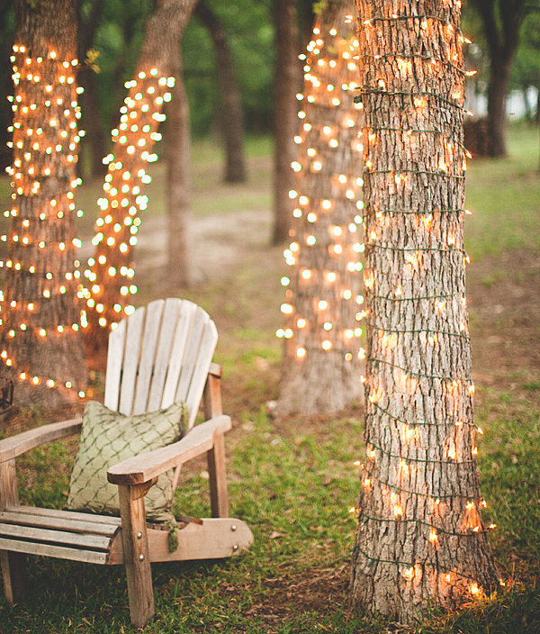 9 ways to decorate with patio lights the honeycomb home for Decorating backyard with lights