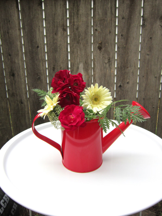 Using just a few sprigs from the yard or a bargain store and a cheap container, you can DIY this cute country floral arrangement!
