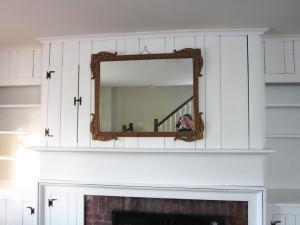 shelves surrounding fireplace