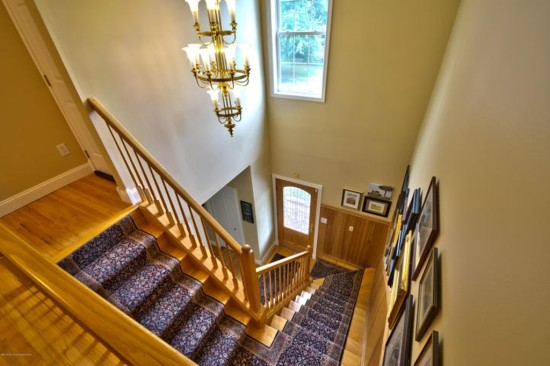 two story foyer with beadboard paneling