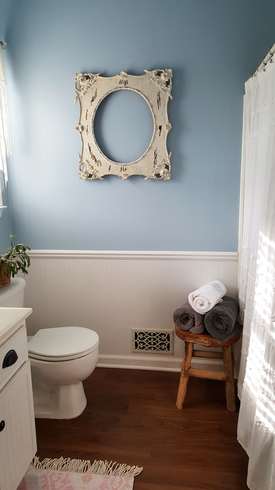 blue bathroom with white wainscotting