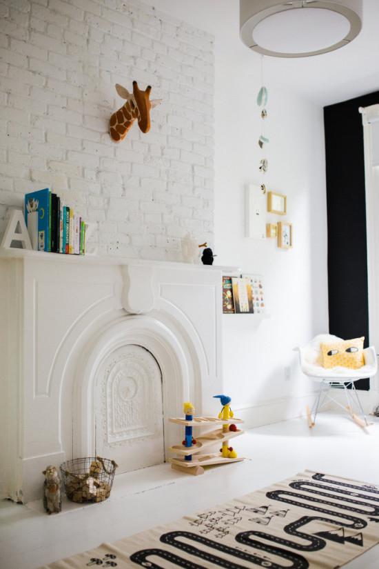 fireplace and white brick wall