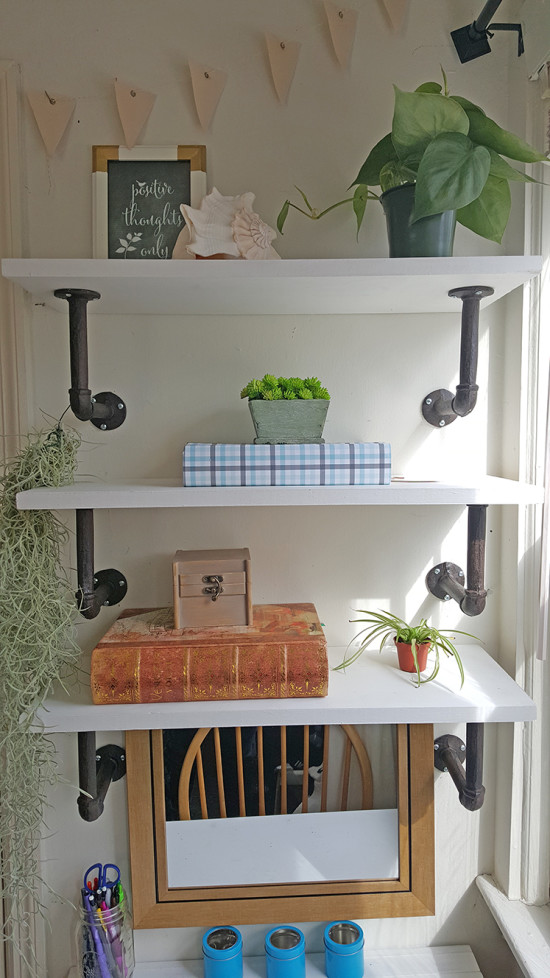 small desk space with diy shelves that also doubles as a vanity