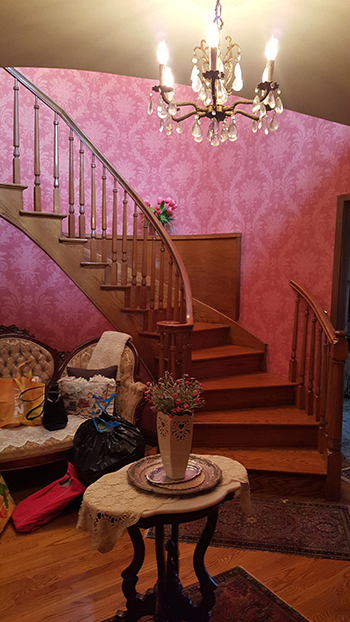 foyer with victorian style wallpaper