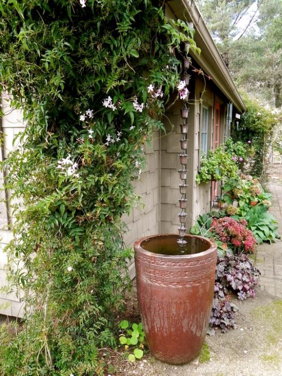 curb appeal ideas rain chain into barrel