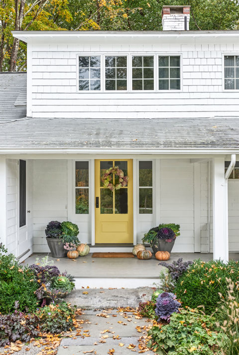 curb appeal tips-yellow painted front door