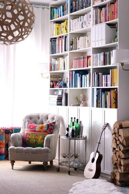 colorful book shelves apartment therapy