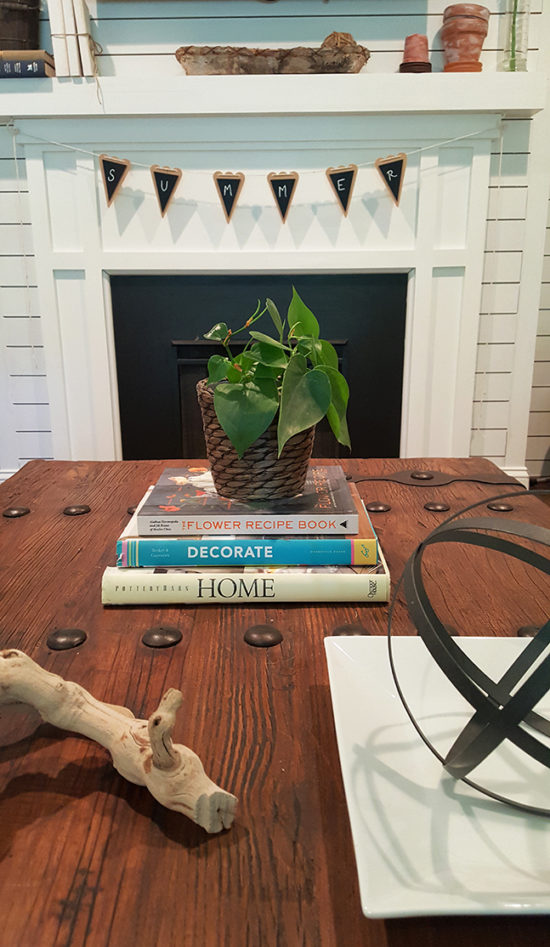 Decorating with books stacked on the coffee table
