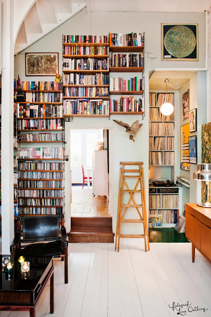 fill a wall with book shelves
