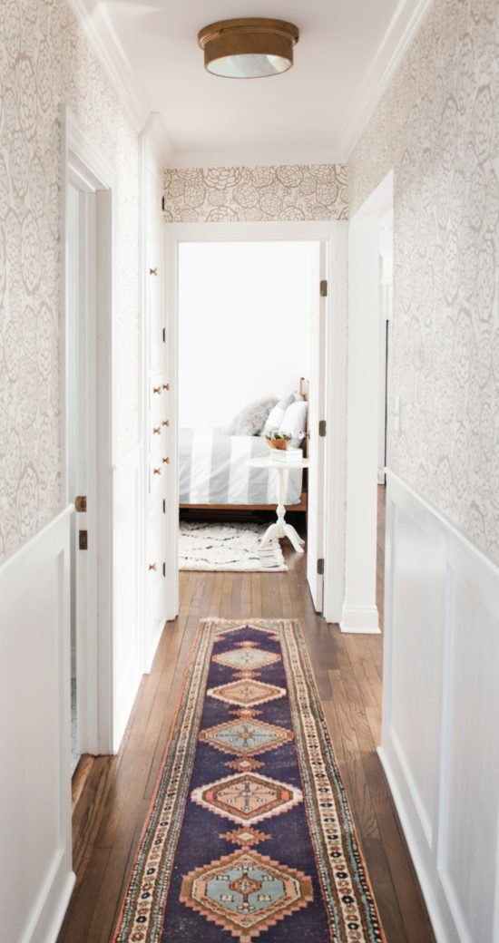 room for tuesday wallpapered hallway