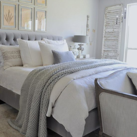 gray-and-white-bedroom-with-tufted-headboard-and-chunky-throw-blanket