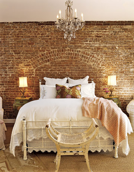 bedroom with feature brick wall