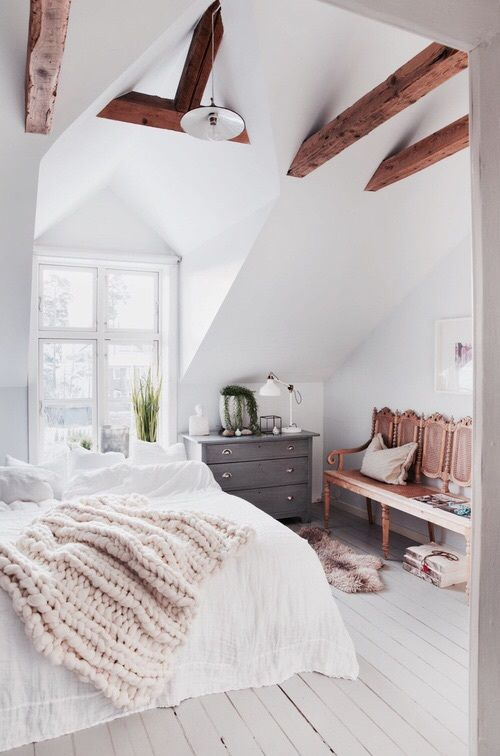 Bedroom with white planked floors