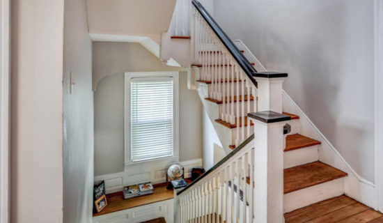 House Tour Staircase landing with window seat