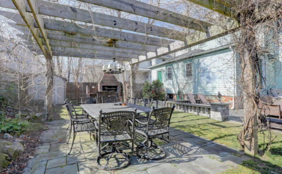 House Tour stone patio with pergola