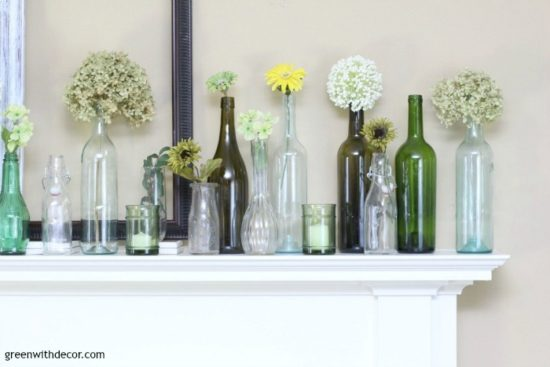 spring-mantel-decorating-ideas-old-glass-bottles-jars-flowers green with decor