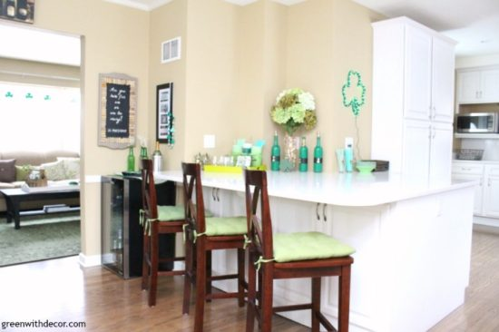 st-patricks-day-party-decorating-white-kitchen-green-accents-wood-floor-quartz-counters-wine-fridge