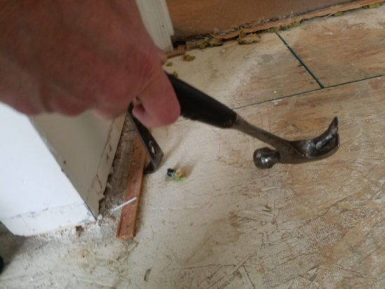 how to remove the tacky strips under carpets
