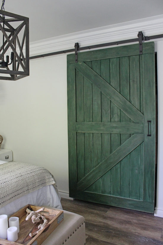 Bedroom makeover Replace bi-fold closet doors with a sliding barn door in farmhouse green.