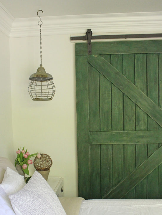 Bedroom Makeover, replace old closet doors with a DIY sliding barn door in farmhouse green.