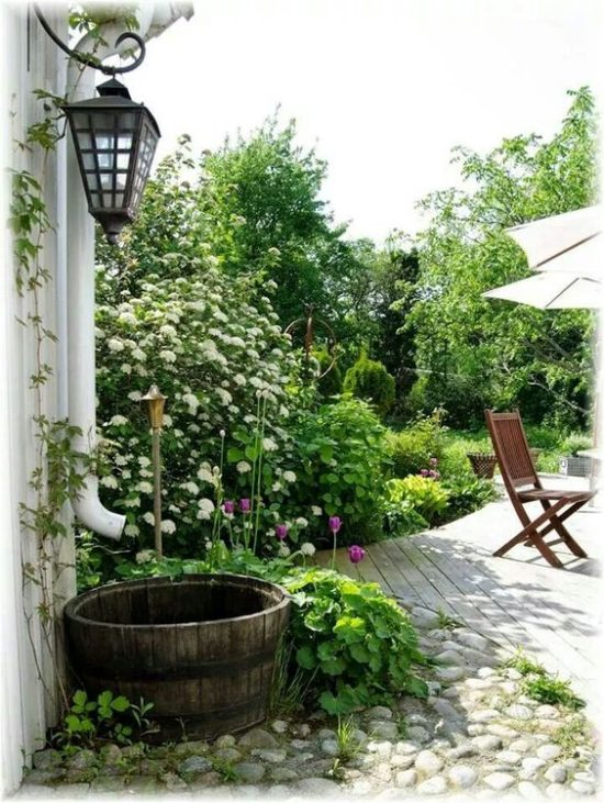 whiskey barrel, white flowers, privacy patio, outdoor spaces