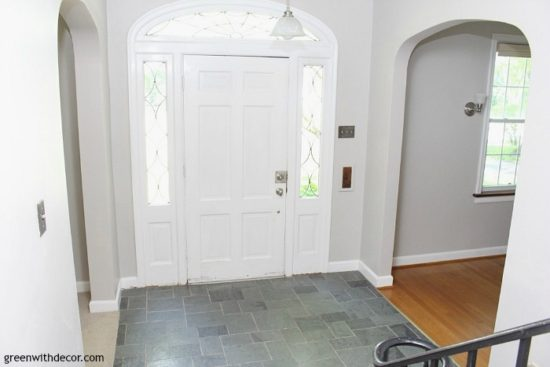 agreeable-gray-painted-foyer-black-railing