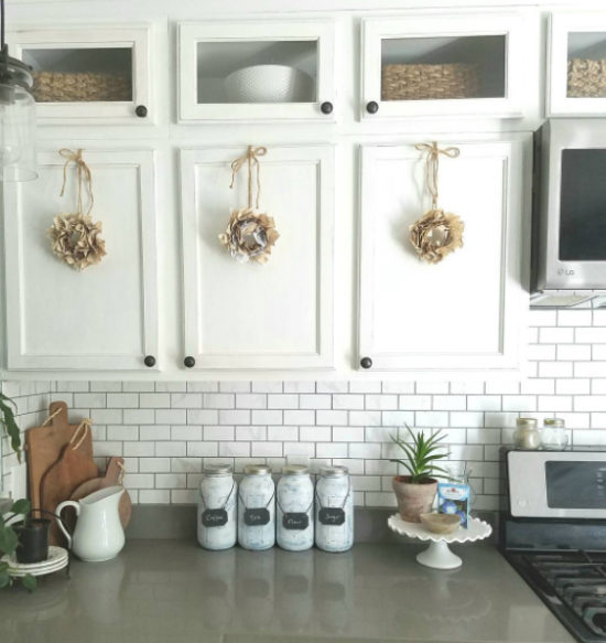 Book page wreaths on cabinet doors