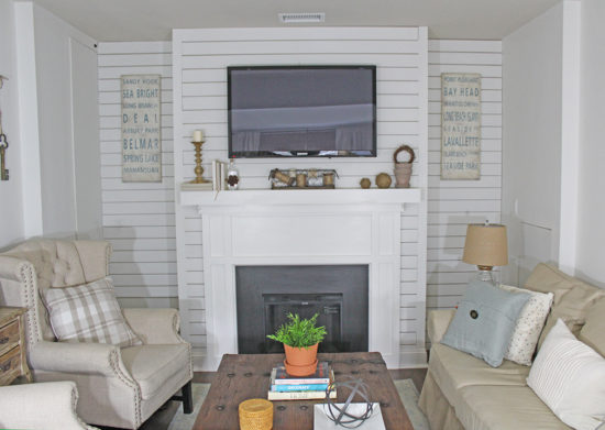 Living Room with Shiplap Wall and fireplace