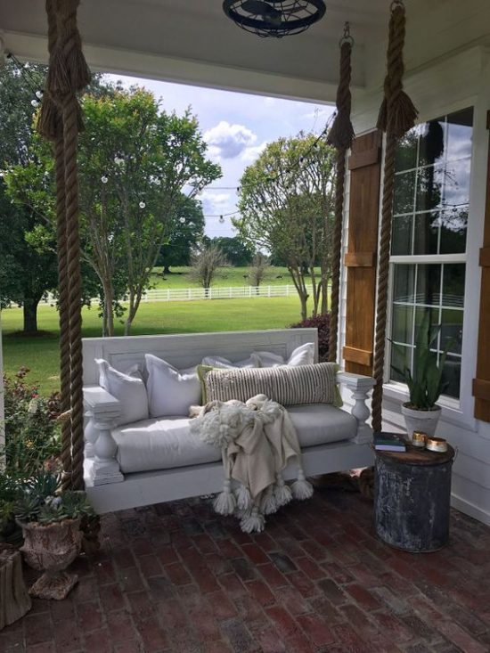 amazing porch with swing seat
