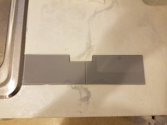 backsplash - how to cut tiles around outlets