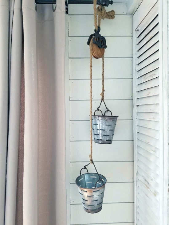Kitchen Storage solutions, metal hanging olive buckets on pulley so cute!