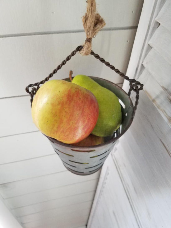 adorable kitchen storage ideas use metal olive buckets on a pulley