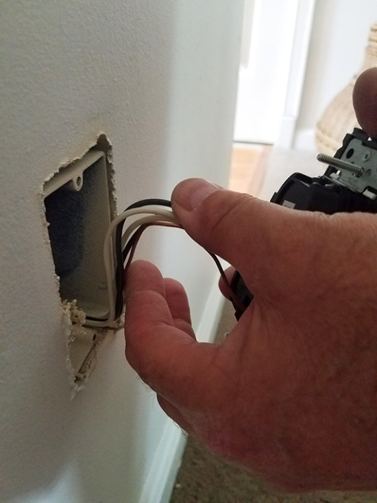carefully fold wires into wall