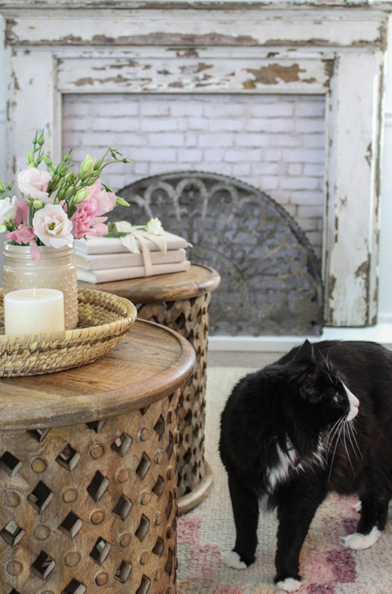 farmhouse living room with pink accents round coffee tables