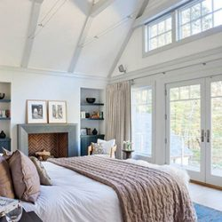 master bedroom with vaulted ceilings and balcony