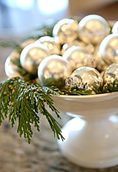 silver ornaments with greenery
