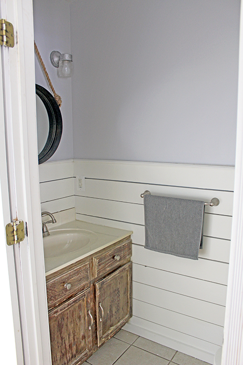 small half bath with shiplap