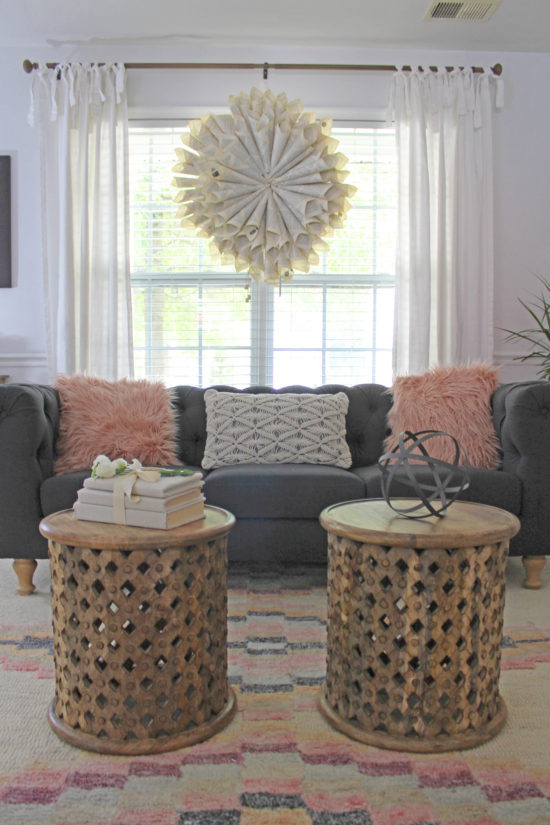 Living room with gray sofa and pink accents