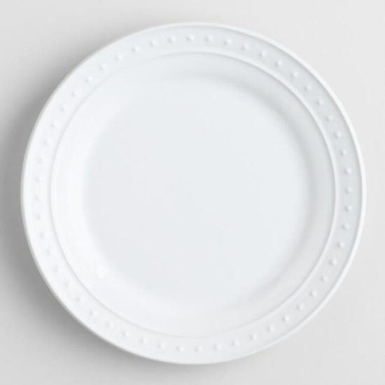 white textured plates table settings