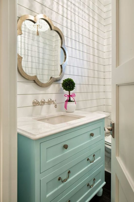 bright bathroom with aqua vanity