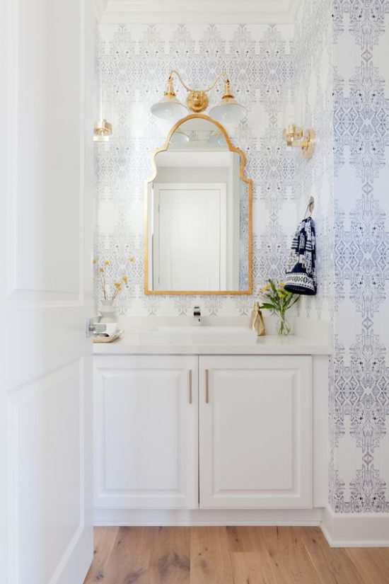 white bathrooms patterned wallpaper gold accents