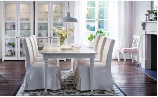 dining room with slipcovered chairs