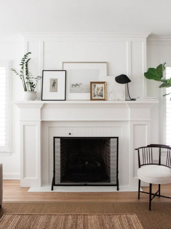 leaning art display over mantel displaying art without making holes in your walls