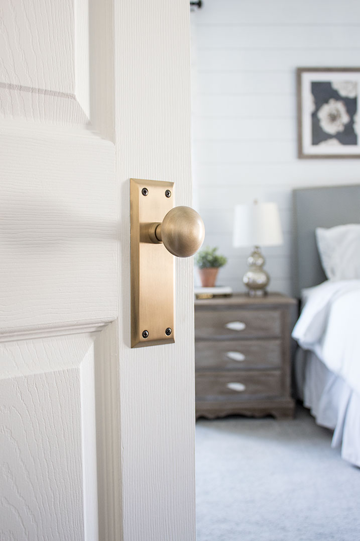 interior doorknobs with a modern-farmhouse vintage style, antique-gold-doorknobs-with-backplate