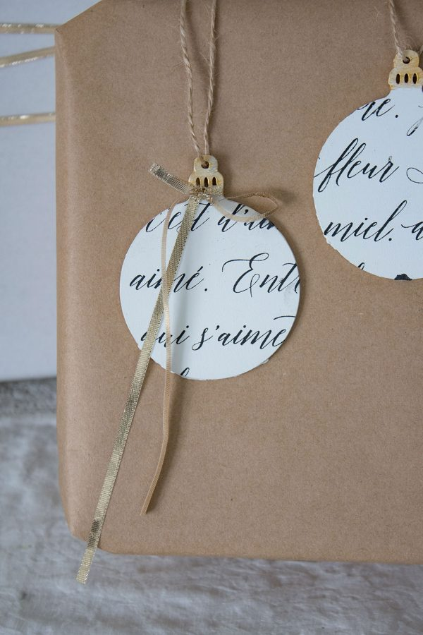 How to make these DIY french script ornaments, great for the tree or to dress up your gifts!
