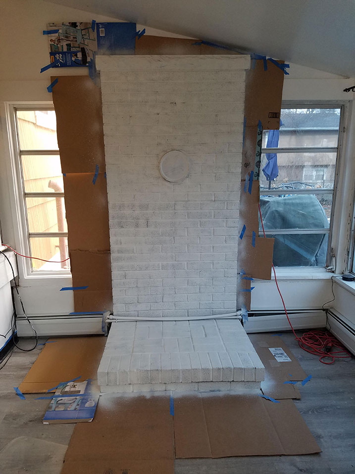 priming a brick fireplace for painting