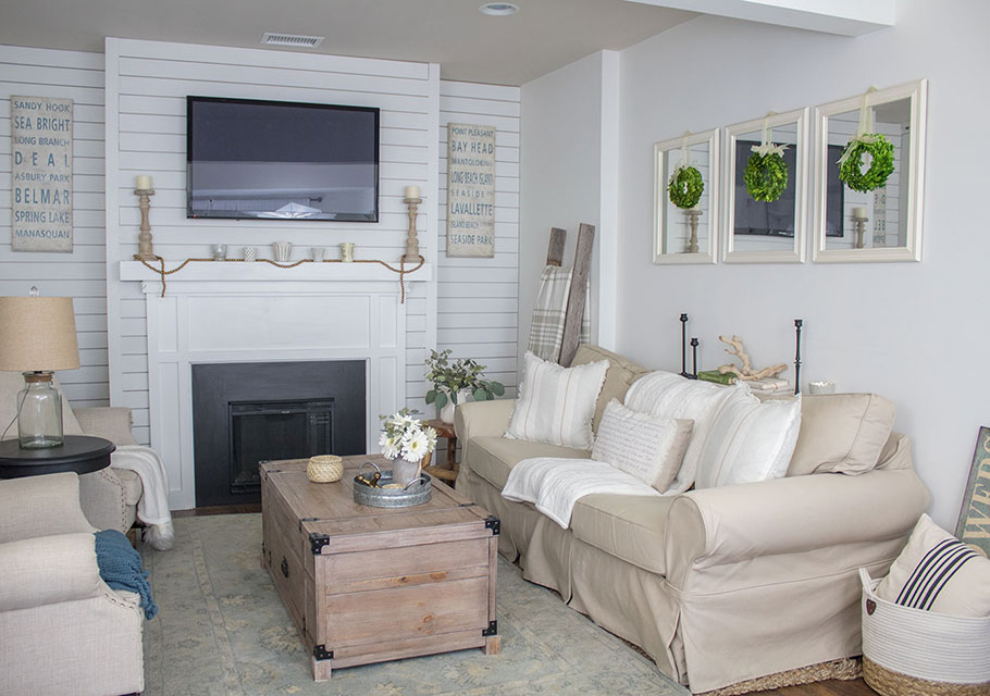 Making-the-most-of-a-narrow-livng-room,-coffee-table-with-storage,-white-shiplap-mantel
